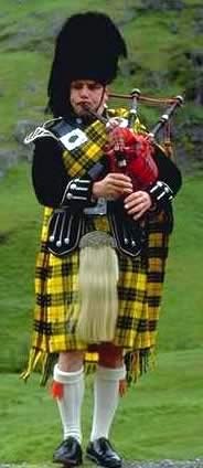 Celtic-instruments image of Scottish piper wearing a traditional kilt, playing the Great Highland bagpipes